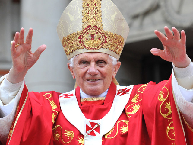 Who are in schism from Pope Benedict XVI?